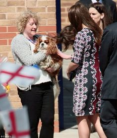 Kate chatted to the locals and took time out to stroke a spaniel