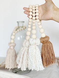 Add a little extra texture to your home with a beautiful tassel. Made with wood beads and high quality yarn they're perfect for a touch of texture and can be used as decor, for wrapping and gift giving. Beautiful neutral colors add just the right amount Wood Bead Garland, Beaded Garland, Diy Tassel, Tassels, Deco Bobo, Bead Crafts, Arts And Crafts, Diy Girlande, Deco Boheme