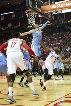 Rockets guard James Harden (13) shoots against Nuggets center Jusuf Nurkic (23) in the second half.