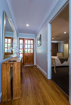 This windowed front door allows natural light flow into the entrance hallway