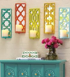 Brighten up with our five colorful, punched-metal Prisma wall sconces- set them up with battery-operated candles, and you're ready to glow.