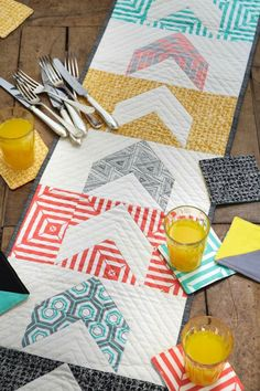 Chevron patchwork table runner and coasters by @Laura Jayson Jayson Jane Taylor using @Lexi Pixel R Taylor Gallery Fabrics fabric - zing! Inside issue 5 of Love Patchwork & Quilting. Photo © Love Patchwork & Quilting