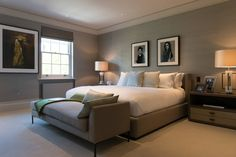 Simple modern bedroom, large bed with white linen and a grey chaise. Bedroom at Bedford Gardens house. : by Nash Baker Architects Ltd
