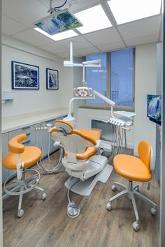 Apricot dental chair upholstery brings a pop of color to this dental operatory