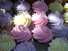 Cupcakes - These cupcakes went with the 1st birthday cake that has the tiara. They are choc and vanilla cupcakes and are all filled with a chocolate whip filling that I pipe in using a med star or straight #6 tip poked through the top. I find using the huge 1G piping tip and large bag to pipe the frosting is THE fastest way to frost these and still look pretty. Thank you everyone for looking!