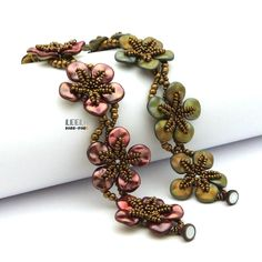 Learn how to make a beautiful flower bracelet, that you can see in Preciosa Ornela ads. Youll receive PDF pattern (instant download) where you will find 11 pages on how to make one for yourself. Pattern includes full step by step description in English, graphic schemes and photos. Supplies: seed beads, Preciosa Ripple beads, pressed round beads 4 mm, clasp Techniques: netting Level of beading skills: Intermediate Please note that this pattern is for personal use only, not for a commercial…