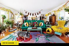 Crazy & I love it. Yellow big bird chair, greenish couch, blue foot stool, stuffed pig? Heads on a chain? // Home Design Spring 2013 - Kathy and Janet Ruttenbergs' Exquisite Homes -- New York Magazine