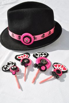 Pink, black and skulls Groom's hat and buttonholes