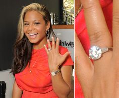 Christina Milian's round brilliant cut engagement ring is flanked by two baguette diamonds.