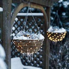 This is such a cute idea!! Amazing Outdoor Christmas Decorations. Make hanging baskets sparkle all winter long by lighting them from within. Use coiled vine baskets without liners, and push a 100-bulb string of small pearl lights from inside to out around each basket. Place clear plastic ornaments in the basket as filler. On top, pile a 50-bulb string of small white lights and a string of prelit metal stars to shine above. #DYI