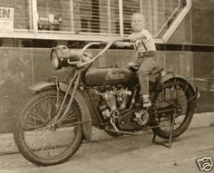 little one on vintage indian motorcycle