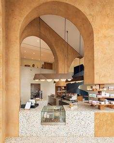 Azaz Architects brings a traditional twist to the newly opened coffee shop, Deco Temple, by the famous Elixir Bunn coffee roasters in Riyadh, Saudi Arabia. Cafe Shop Design, Restaurant Interior Design, Brewery Interior, Terrazzo, Architectural Digest, Architectural Sketches, Architectural Photography, Cat Ideas, Bunn Coffee