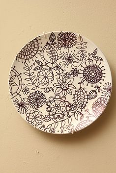 DIY Plate spray painted white & the  design is drawn with a black Sharpie  2 or 3 plates on each side of the tv on the mantel                                                                                                                                                                                 More