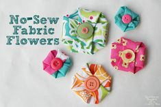 adorable no sew fabric flowers.  great tutorial over at scatteredthoughtsofasahm.blogspot.com