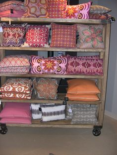 Check out these fun throw pillows that come in bright colors like orange and pink! #bold_patterns #accent_pillows #colorful   Houston TX   Gallery Furniture  