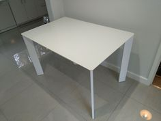 Extendable version of Link dining table with white glass top and gloss white frame. Available in other sizes and configurations. Delivered to our clients in Bromley.
