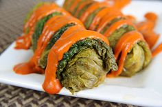 Enlightened Braised Cabbage Rolls with Roasted Red Pepper Sauce