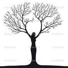 female silhouette in tree trunk