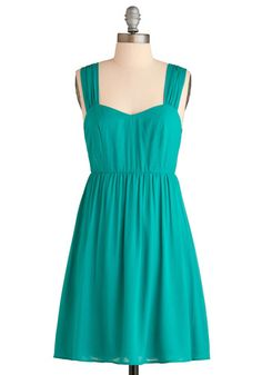 Teal It to My Heart Dress  This dress is cute and fun with the tie-back opening, and a peek of your beautiful back just to tease the gentlemen. Would look great with gold flats, or for an element of surprise, a pair of peach tone wedges.