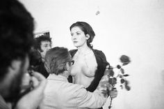 Rhythm 0 (1974), artist Marina Abramović allowed people to use any of 72 objects on her in any way that they chose for six hours. She stood totally passive and surrendered control of her body to the participators. At first people reacted with modesty and caution, but as time passed, people began to act more aggressively. The consistent allowance of trust juxtaposed the increasing degree of violence she received, as those intimate actions were not subject to her approval.