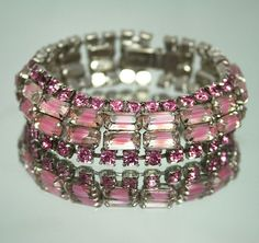(circa approx. 1950's) Kramer bracelet featuring four rows of pink rhinestones and baguettes.