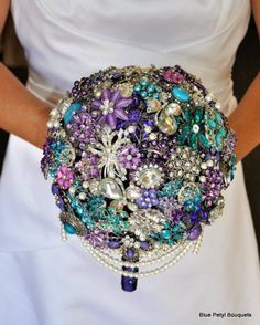 Teal Violet Purple brooch bouquet ~ what an utterly fabulous use for antique brooches!