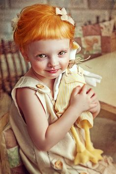 This child looks like a doll...