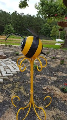 This is my first attempt with bowling ball garden art and my first time posting. First, I painted the ball Marigold yellow. Bowling Ball Crafts, Bowling Ball Garden, Bowling Ball Art, Garden Balls, Bowling Pins, Bowling Ball Ladybug, Diy Garden Decor, Garden Crafts, Garden Whimsy