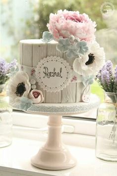 White wood and pastel flower by Cotton and Crumbs