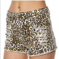 "MINKPINK Runaway Leopard Slashed High Waist Short This SUPER cute MINKPINK leopard short is the perfect edgy addition to your wardrobe! It's for tiny-waisted girls though, probably size 0 or 00 - measured flat, the waist is 12"". MINKPINK Shorts"
