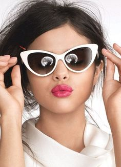 Selena Gomez - This is such a cool look for her. Love the sunglasses and pink pout!
