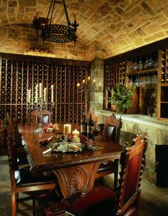 Magnificent Antique Wine Jugs Decor Ideas in Wine Cellar Rustic design ideas with Magnificent barrel vault built-in storage candelabra carved wood cave stone ceiling stone floor