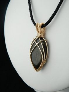 Check out this item in my Etsy shop https://www.etsy.com/uk/listing/400199715/golden-obsidian-pendant-wire-wrapped