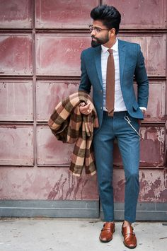 Really smooth teal-hued suit here, brought to life with this printed scarf! #menswear