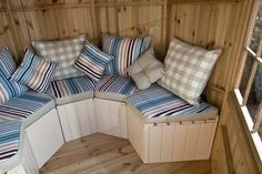 Summerhouse interior in pressure treated finish with seating & upholstery in Truro fabric