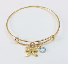 Pisces- Depth, Imagination, Reactive  Gold plated adjustable bangle with gold plated pisces zodiac sign and swarovski march birthstone charms.  $22 available @ http://shareindipity-com.myshopify.com/collections/zodiac-collection