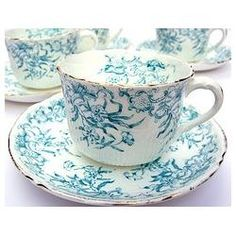 A delicate turquoise-on-white pattern adorns these pretty vintage tea cups and saucers. (aqua, turquoise, color)