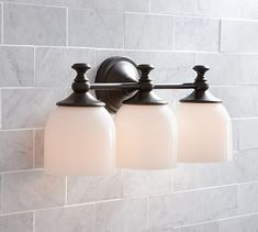 """Our Mercer Triple Sconce is marked by graceful curves and a stepped medallion base. 18.5"""" wide x 6.5"""" deep x 8.5"""" high Cast of drop-forged sheet metal and thick  $159"""