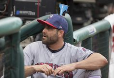 Francisco Cervelli Photos Photos - Francisco Cervelli #29 of the Pittsburgh Pirates sits in the dugout during the third inning with a Powerade cup stuck on his hat against the Philadelphia Phillies at Citizens Bank Park on July 4, 2017 in Philadelphia, Pennsylvania. The Pirates defeated the Phillies 3-0. - Pittsburgh Pirates v Philadelphia Phillies