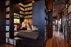 Casey & Rebekah Vallance - A book-lined daybed in the library offers a contained space in which to retreat.