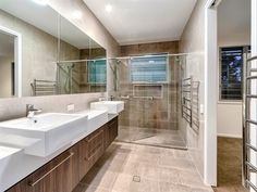 Konstruct Interior Solutions - vanity, tile, window in shower, niche, stone.