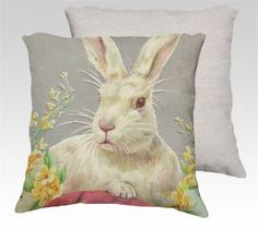 DECORATIVE VELVETEEN PILLOW COVER FEATURING LARGE WHITE EASTER BUNNY RED EGG AND SPRING FLOWERS   This is a beautiful soft velveteen decorative pillow cover in bright spring colours. A large white bunny rabbit sits with one paw casually perched upon a red egg. Yellow spring flowers give away his hiding spot in the spring garden. The velveteen fabric is perfect for this bunny and is as soft as he is. The image was taken from an antique postcard. The back of the cover is a creamy white…