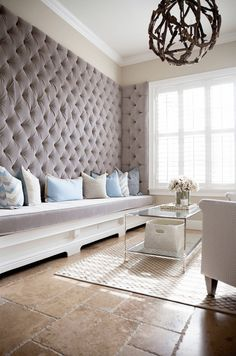 Tufted Living Room Wall- A tufted feature wall in a living room creates a luxurious space.#livingroom #luxury