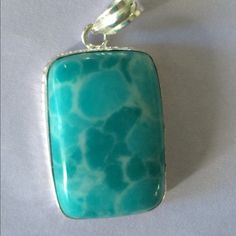 "Beautiful Larimar.925 STERLING SILVER PENDANT  Awesome Larimar Sterling Silver Pendant comes with h a Sterling Silver Chain as well the stone itself measures 1 1/2"" so about 2"" long with bail Jewelry Necklaces"