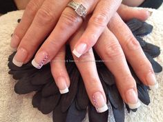 Acrylic nails with French polish and dimonties on ring