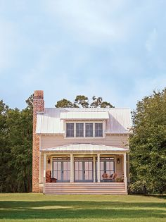 Lowcountry river cottage on Johns Island, South Carolina by architect Cooter Ramsey | #bevolo Williamsburg Lantern