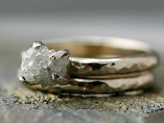 thin, hammered ring with a raw stone