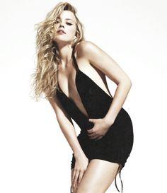 Amber Heard as Eva Tramell #crossfire (Bared to you) Eva's black short dress at Gideon's club.