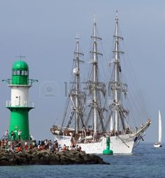 PORT WARNEM�NDE, GERMANY - AUGUST 10  Old norwegian Sailing ship  Christian Radich  is passing the light beacon on August 10, 2013 in the scope of the 23   Hanse-Sail  at the port Rostock-Warnem�nde  Mecklenburg-Vorpommern, Germany   Stock Photo