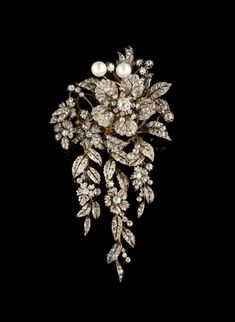 "A large diamond and natural pearl """"en tremblant"""" corsage brooch. Set in silver and gold with two natural pearls, rose cut diamonds and 38 old mine cut diamonds with total weight of ca. 4,15ct."